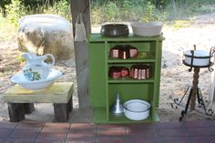 Mud pie kitchen.  Love the idea of the old pitcher and bowl  let the children play: mud pie kitchens galore