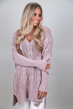 Every girl loves a big, slouchy, oh-so-comfy knit! This one hits the spot. Lavender in color. Cable knit sweater. 100% cotton. Model is a 3/4, wearing an S/M. Please note: this sweater fits very loose