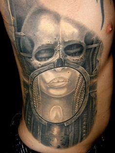 TATTOO BY TAMS KOVACS........SOURCE H.R. GIGER MUSEUM...........