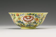 A FINE AND RARE YELLOW-GROUND ENAMELED 'FLORAL' BOWL QIANLONG SEAL MARK AND PERIOD