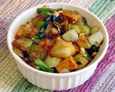 Delectable Tofu Bok Choy Stir Fry, with Scallions, Garlic, Peanuts. Recipe courtesy Nava Atlas, Vegetarian Kitchen. Keep it simple by using a prepared stir-fry sauce; serve over noodles or rice for a nourishing, satisfying meal.