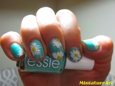 miniatureart:    Margarita Flowers!  I used:  1. Turquoise and Caicos by Essie  2. All the white stuff by Sally Hansen  3.Cosplay by Sally Hansen  Happy Spring!!