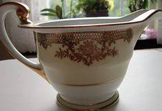 This stunning vintage fine china Creamer was made in the 1930s by Noritake China. The pattern name is Revenna, and it is considered one of the most beautiful pieces of china made by Noritake. This dinnerware pattern #7270 was made in the 1930s. It is exquisitely hand-painted gold-gilt on cream and white. It stands 2 7/8 tall . I will be listing matching pieces on this site, so please see my other auctions or contact me for additional information on available pieces.  Noritake fine porcelain…