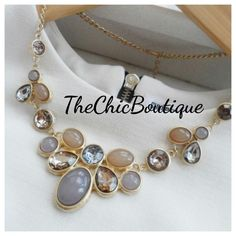 A beautiful gold necklace with sparkly stones in tan, brown and clear.  Fast and Free shipping in the U.S   Shop this product here: http://spreesy.com/TheChicBoutique/245   Shop all of our products at http://spreesy.com/TheChicBoutique      Pinterest selling powered by Spreesy.com