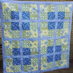 A personal favorite from my Etsy shop https://www.etsy.com/listing/254608105/table-top-quilt-blue-green-yellow-throw