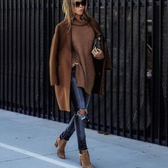 ripped jeans, camel coat