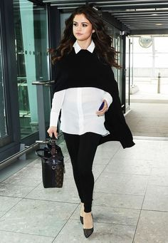 Selena Gomez black and white airport look