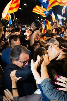 President of Catalonia Artur Mas shakes hands with wellwishers after the Catalanist coalition 'Junts pel Si' (Together for the Yes) won the regional elections held in Catalonia on September 27, 2015 in Barcelona, Catalonia.