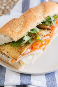 If you happen to live in Saigon/Ho Chi Minh City, Southern California, New York, or anywhere with a Vietnamese population, I hope you have experienced the wonders of bánh mì – baguettes filled with pickled carrots and daikon, fresh cilantro, and meat or tofu. The sandwiches are crisp, salty, tangy, and sweet; the perfect marriage of French and Vietnamese influences. But if you don't have a local bánh mì shop or just want to make a vegetarian version at home, here's a recipe for a…