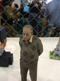 Saw this at MakerFaire.  This guy is 3D printed in full color using a gypsum-deposition + ink technology.  Wow.  I've seen the future.