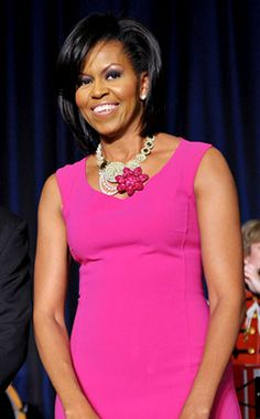 Popping Pink from Michelle Obama's Best Looks  The luminous first lady chooses a hot-pink wool Michael Kors get-up with a matching flower necklace at the White House Correspondents' Association dinner.