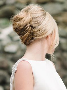 Sweep your beautiful locks into a twisted French updo for a chic wedding hairstyle suitable for brides and bridesmaids alike.