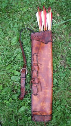 Archers Quiver with shoulder strap,bow straps and bottom using a tooled oak leaf design. The quiver is dyed using a block dye technique I use for Archery Quiver, Archery Gear, Archery Bows, Crossbow Hunting, Larp, Leather Quiver, Medieval, Elf Cosplay, Archery Equipment