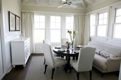 Urban Grace Interiors: Chic dining room design with gray sofa, espresso round dining table, white dining chairs ...