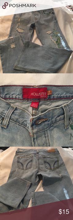 "Hollister Brand light blue jeans ripped design Nice Hollister Brand light blue jeans.  Size 7. Inseam 28"" Soft Jean with left leg blue-green and yellow accent design as well as on the left pocket.  Nice condition. Hollister Jeans Flare & Wide Leg"