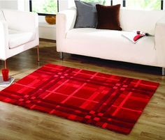 This fabulous red rug 160x230cs is only £139.  It looks great teamed up with a throw and cushions for the luxury faux fur range at www.thesofathrowcompany.com