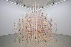 An anonymous trio of artists, known simply as three, have been collaborating on politically driven art installations that incorporate a playfully colorful aesthetic. Using individually wrapped pieces of candy and fish-shaped soy sauce packets, the artists have constructed a number of works that invite viewers to interact with them.