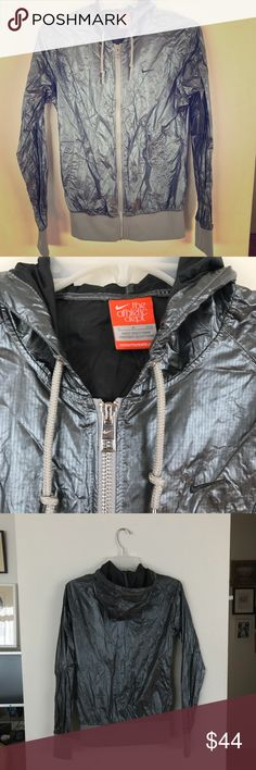 Nike Hooded Jacket Silver Waterproof Hooded zip up jacket by Nike. This sporty jacket is space age looking and super rad. From a non smoking home. Fast shipping. Nike Jackets & Coats