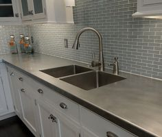 Stainless Steel Countertop, Sink, Glass Tile Backsplash