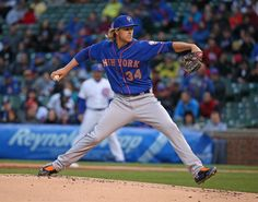 Starting pitcher Noah Syndergaard #34 of the New York Mets makes his Major League debut against the Chicago Cubs at Wrigley Field on May 12, 2015 in Chicago, Illinois.