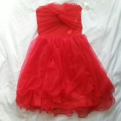 NWOT Red Tulle Dress Stretchy back. Side zipper. Can attach straps (does not come with straps). One size, but fits like a small. Padded front.   Bundle for a deal. :) Dresses