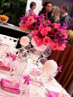 fun bubble vases from accent decor topped by roses and bougainvillea