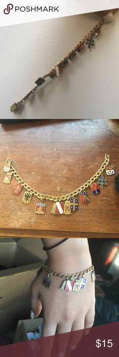 Charm bracelet Antique gold charm bracelet with multiple family crest charms. Good condition, antique look. Jewelry Bracelets