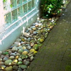 i was thinking about gravel around the house (about a foot deep) for drainage but this looks so much prettier than gravel!
