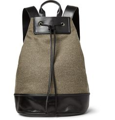 <a href='http://www.mrporter.com/mens/Designers/Dries_Van_Noten'>Dries Van Noten</a>'s backpack exudes fuss-free utilitarian appeal. Crafted from a khaki felted wool-blend, it's trimmed with leather for added durability and polish. The concealed zipped pocket at the back is ideal for keeping your keys and phone within reach, especially if a cramped train carriage is part of your daily commute.