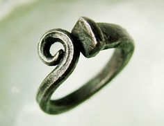 Scrolled Iron Nail Ring by CitiZenoBjeCts on Etsy   An updated design for an old-timey tradition, these rings are hot formed from 100+ year old square nails. All of my nails are pulled by me from houses undergoing renovation in New Orleans' Historic Bywater and Marigny neighborhoods. All nails show signs of age and use, each one being unique.