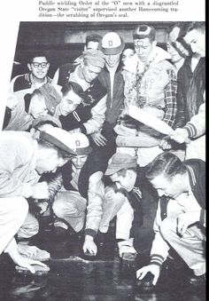 Freshmen polish the Oregon seal during 1955 homecoming while a captured Oregon state fan looks on. From the 1956 Oregana (University of Oregon yearbook). www.CampusAttic.com