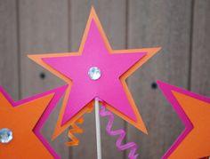Star centerpiece idea.  Use green, blue & pink.