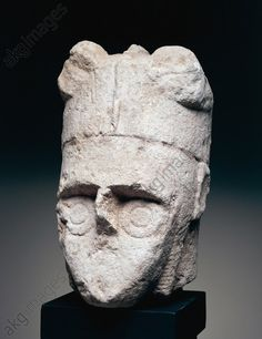 Head of a warrior, stone carving, from Mont'e Prama, Cabras, Sardinia, Italy. Nuragic civilisation. Nuoro, Museo Civico Speleo-Archeologico (Archaeological Museum)