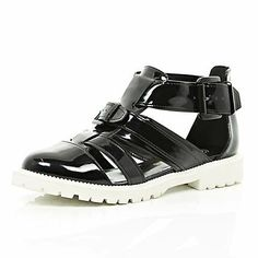 Black patent cut out cleated sole shoes $70.00