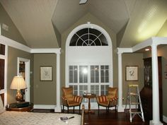just painted the wall between windows trim color and walls closer to wooden ceiling color! www.bertjohn.com
