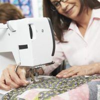 While quilting is a rewarding process, it can be fraught with snags -- luckily, spray glue can help. This adhesive holds the layers of a quilt together while they are are basted and stitched. Water, vodka and liquid starch are key to creating this quilt-saver.