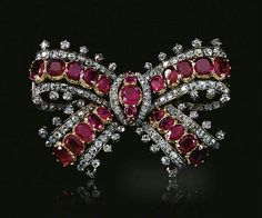 Ruby and diamond bow brooch, Mid 19th Century.