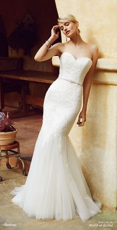 Combined with an exquisite beaded appliqué at the waist, a soft sweetheart neckline with sequins and delicate beading on corded lace over Chantilly lace makes this full-length, mermaid gown a vision of romance and beauty. The look is complete with a center back zipper.