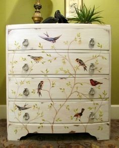 The body of the chest was painted Cloudy Morning  The branches were painted with acrylic craft paint. vintage bird graphics printed them on card stock and used Mod Podge to decoupage them onto the front of the chest.