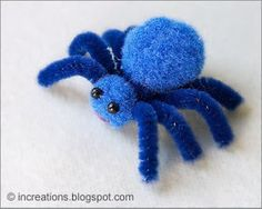 Spider toy made of pompoms