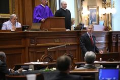 State Sen. Paul Thurmond, R-Charleston, calls for the removal of the Confederate flag from the Statehouse grounds during a speech on the Senate floor Tuesday.