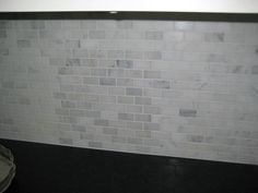 My mini brick marble backsplash was finally installed this week, and as I had a few requests here are my installed pictures. I only had a the backsplash done on my hutch area, but I really like how it turned out. It was called oriental white mini brick, and is polished. I think it contrasts well wit...