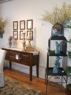 Bird Cage at Ashley Furniture.  I love using a bird cage as an accessory.  You can fill it with birds, flowers or for Christmas... use it to fill with gifts!