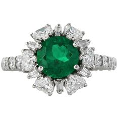 2.02 Carat Colombian Emerald Diamond Platinum Ring | From a unique collection of vintage cluster rings at https://www.1stdibs.com/jewelry/rings/cluster-rings/