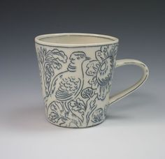 I own two of her pieces and COVET more.  Molly Hatch ceramics.  There are designs on the bottom of the cup, too.  Swoon.