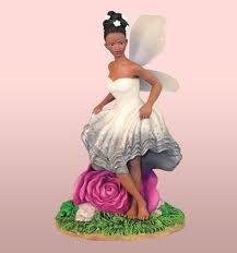 Shop for and add to your collection the fairy collectible figurines. This fairy figurine with rose is 9 inches in height and made from poly resin material. African Imports, African American Figurines, Fairy Garden Houses, Fairy Gardens, Mini Gardens, Fairy Wallpaper, Black Fairy, Image Gifts, Fairy Figurines