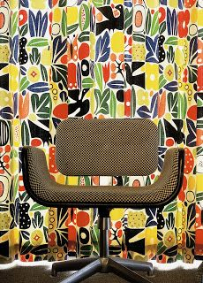 Girard chair in front of Girard fabric. Photo by Eric Laignel courtesy Interior Design magazine