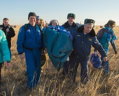 Expedition 37 NASA Flight Engineer Karen Nyberg gives the thumbs up as she is carried to the inflatable medical tent after her landing in the Soyuz TMA-09M spacecraft in a remote area southeast of the town of Zhezkazgan, Kazakhstan, Nov. 11, 2013, Kazakh time.  Image Credit: NASA/Carla Cioffi