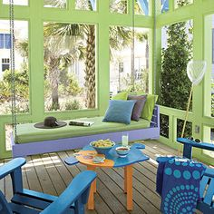 Our Favorite Porch Swings: Colorful Coastal Porch Swing