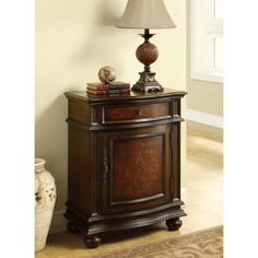 Update your home decor with this cherry wood cabinet. Its traditional style and warmth will instantly enhance any home. This cabinet features one drawer for storage. The antique silver hardware and detailed trim complements this piece.